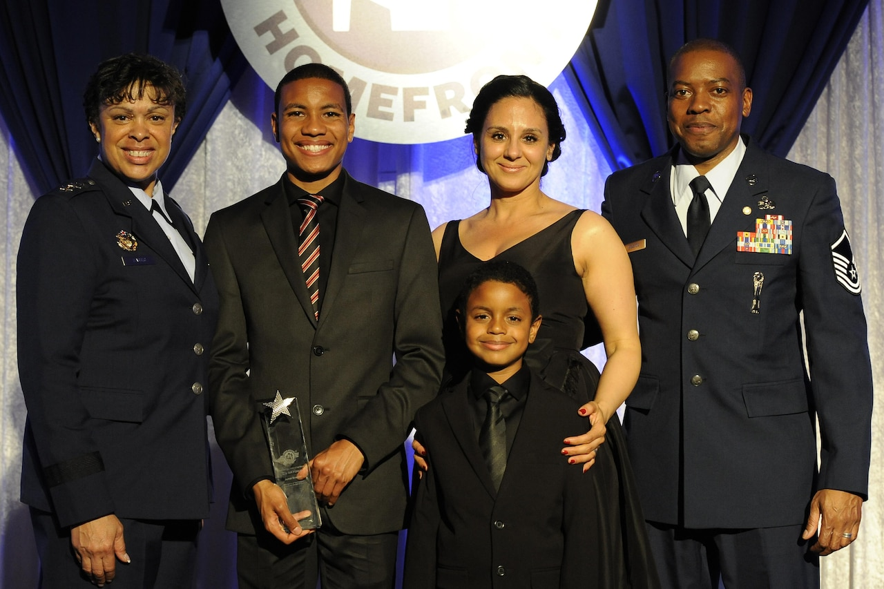 Eighteen-year-old Jamal Braxton receives the 2017 Air Force Military Child of the Year award from Air Force Assistant Vice Chief of Staff Lt. Gen. Stayce Harris during a gala in Pentagon City, Va., April 6, 2017. Braxton, of Layton, Utah, is the son of retired Master Sgt. Lawrence Braxton and Ahllam Braxton. The annual event celebrates military children who demonstrate leadership, resilience and strength of character, as well as an ability to thrive when dealing with the challenges inherent in military family life. Air Force photo by  Staff Sgt. Jannelle McRae