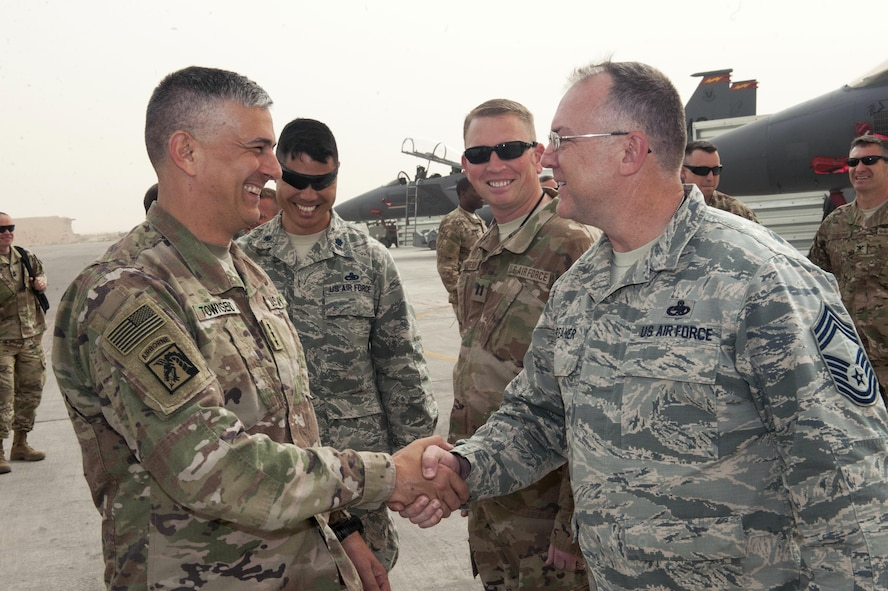 U.S. Army Lt. Gen. Stephen Townsend, Combined Joint Task Force – Operation Inherent Resolve commanding general, shakes hands with U.S. Air Force Chief Master Sgt. Raymond Phreaner, 332nd Expeditionary Maintenance Squadron, chief enlisted manager April 5, 2017, in Southwest Asia. The general visited Airmen and Soldiers thanking them for their contribution to the mission. (U.S. Air Force photo by Tech Sgt. Eboni Reams)