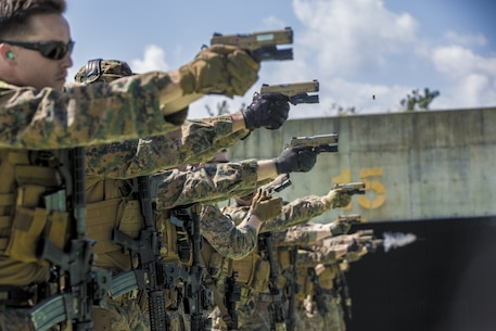 Force reconnaissance Marines with Maritime Raid Force, 31st Marine Expeditionary Unit, fire M45A1 pistols during a range at Camp Hansen, Okinawa, Japan Feb. 27, 2017. MRF specializes in amphibious reconnaissance, vessel Visit, Board, Search, and Seizure operations and limited combat operations as the reconnaissance element of the 31st MEU. As the Marine Corps' only continuously forward-deployed unit, the 31st Marine Expeditionary Unit's air-ground-logistics team range of military operations, from limited combat to humanitarian assistance operations, throughout the Indo-Asia-Pacific region. (U.S. Marine Corps photo by Cpl. Jona R. Meme/Released)