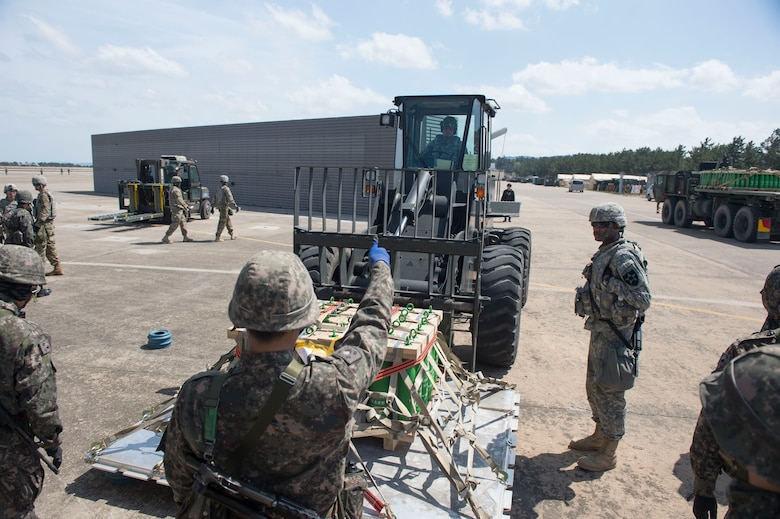 U.S. Air Force Staff Sgt. Matthew Blair (inside forklift), an aerial porter assigned to the 621st Contingency Response Wing stationed at Joint Base McGuire-Dix-Lakehurst, N.J., is given a thumbs up by a Republic of Korea Air Force Airman after successfully directing Blair place cargo on the ground as they conduct combined training during exercise Turbo Distribution 17-3, at Pohang Air Base, Republic of Korea, April 10, 2017. (U.S. Air Force photo by Tech. Sgt. Gustavo Gonzalez/RELEASED)