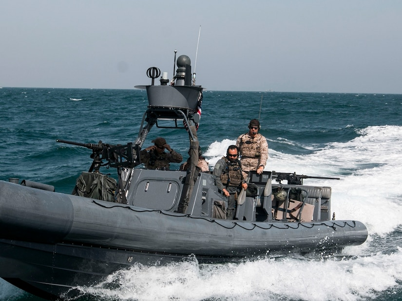Members of the Navy's Special Boat Team ride up to pick up the  Soldiers from the 3rd Battalion, 8th Cavalry Regiment, 3rd Armored Brigade Combat Team, 1st Cavalry Division and transport them to an oil tanker somewhere in the Persian Gulf. Soldiers from Co. B, 3-8 CAV played the opposing force for a joint training exercise, called Eagle Resolve, between U.S. special operations forces and SOF elements from Qatar, Kuwait, Saudi Arabia, and United Arab Emirates. (U.S. Army photo by Staff Sgt. Leah R. Kilpatrick, 3rd Armored Brigade Combat Team Public Affairs Office, 1st Cavalry Division (released)