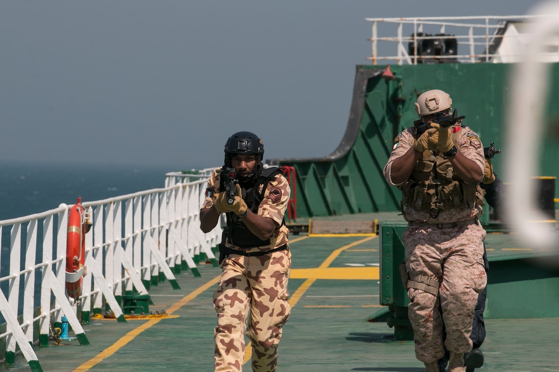 Two Kuwaiti special operations troops search an oil tanker somewhere in the Persian Gulf for the opposing force in a vehicle board, search and seizure training operation. Soldiers from Company B, 3rd Battalion, 8th Cavalry Regiment, 3rd Armored Brigade Combat Team, 1st Cavalry Division played the opposing force for a joint training exercise, called Eagle Resolve, between U.S. special operations forces and SOF elements from Qatar, Kuwait, Saudi Arabia, and United Arab Emirates. (U.S. Army photo by Staff Sgt. Leah R. Kilpatrick, 3rd Armored Brigade Combat Team Public Affairs Office, 1st Cavalry Division (released)