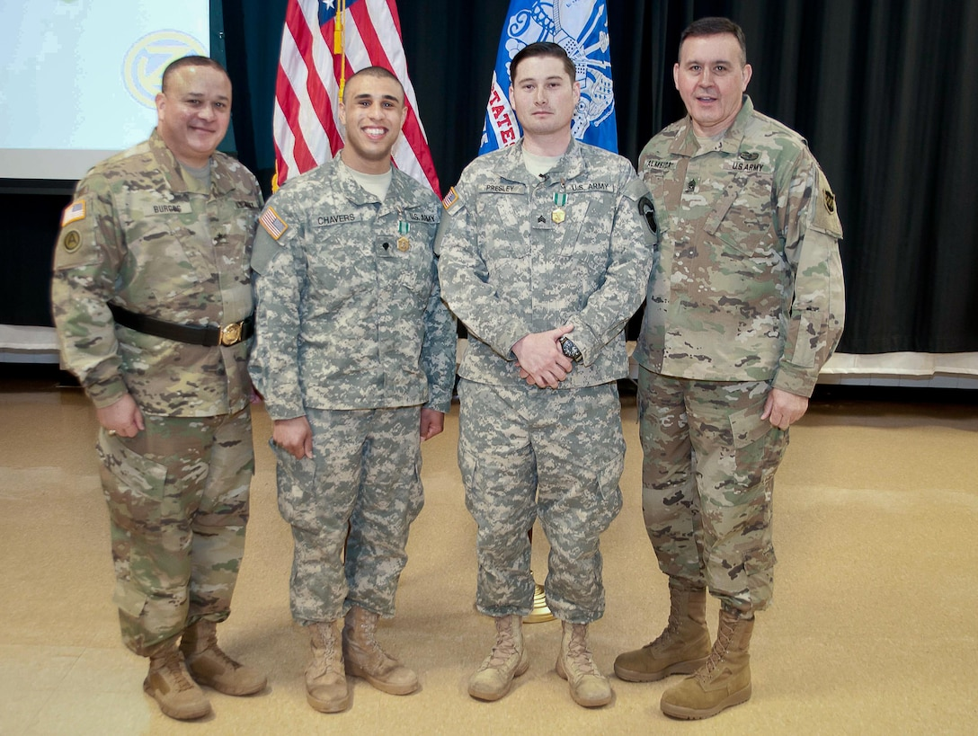 The winners from the 99th Regional Support Command, Sgt. Curtis Presley, 380th Army Band (center, right) and Spc. Aaron Chavers, 198th Army Band (center, left) pose with Brig. Gen. Jose Burgos, Deputy Commanding General (far left) and Command Sgt. Maj. Arlindo Almeida, (far right) Command Sergeant Major of the 99th Regional Support Command pose for a picture with the winners of the command's 2017 Best Warrior Competition at Fort Devens, Massachusetts on 6 April 2017. Of the 11 competitors from the command, these Soldiers stood out amongst their peers in the Junior Enlisted and Noncommissioned Officer categories and will move on to the U.S. Army Reserve Command's 2017 Best Warrior Competition slated for June.