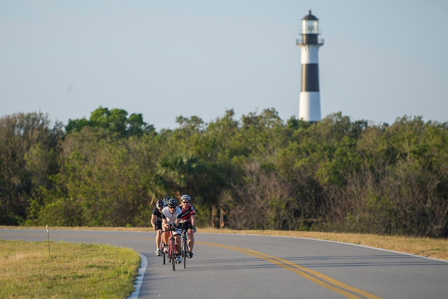 Airmen participate in a Cape Canaveral Air Force Station bike tour, emphasizing that fitness and a healthy lifestyle are essential to being a well-rounded Airman March 30, 2017. (U.S. Air Force photo/Phil Sunkel)