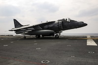 An AV-8B Harrier pilot with Marine Attack Squadron 311, 31st Marine Expeditionary Unit, signals to flight deck personnel during flight operations aboard the USS Bonhomme Richard March 9, 2017. Marines and sailors of the 31st MEU embarked aboard the USS Bonhomme Richard, part of the Bonhomme Richard Amphibious Readiness Group, as part of their annual spring patrol of the Indo-Asia-Pacific region. The 31st MEU, embarked on the amphibious ships of the Expeditionary Strike Group 7, has the capability to respond to any crisis or contingency at a moment's notice.