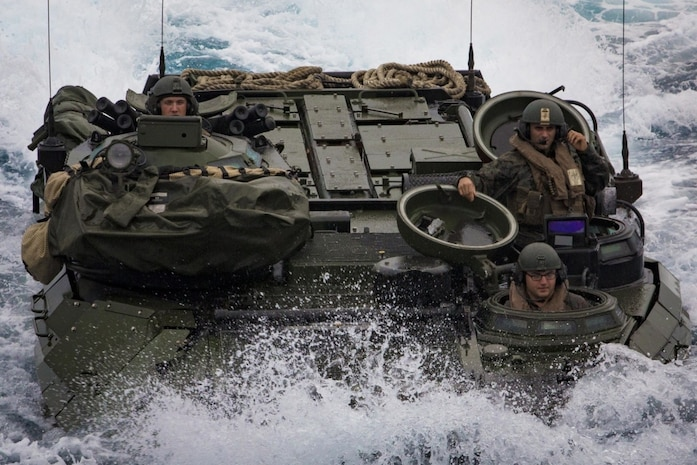 A Marine Corps AAV-P7/A1 assault amphibious vehicle with Battalion Landing Team, 2nd Battalion, 5th Marines, 31st Marine Expeditionary Unit, maneuvers off the coast of Okinawa, Japan, March 8, 2017. AAVs maneuvered into the well deck of USS Ashland as part of the 31st MEU's regularly scheduled spring patrol aboard ships of the Bonhomme Richard Amphibious Ready Group.