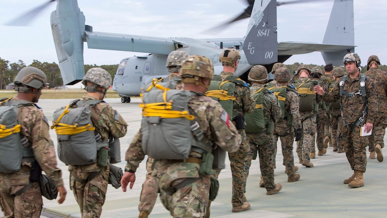 Marines and soldiers board an MV-22B Osprey during an air-drop delivery jump exercise at Marine Corps Auxiliary Landing Field Bogue, N.C., March 27, 2017. The training was part of field exercise Bold Bronco 17, which allowed the Marines to demonstrate their transportation support skills in various environments. The Marines are with 2nd Transportation Support Battalion, 2nd Marine Logistics Group and the Soldiers are with 647th Quartermaster Company, 3rd Expeditionary Sustainment Command.