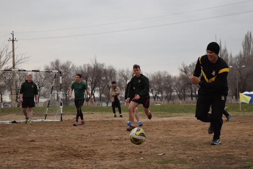 An Arizona National Guard Soldier races for the ball during a game of soccer against the U.K. soldiers with 1st Battalion, The Rifles, 160 Brigade, Apr. 2, 2017, at Illisky Training Center, Kazakhstan. The soldiers are participating in Steppe Eagle Koktem, phase one of the multinational Steppe Eagle Exercise.