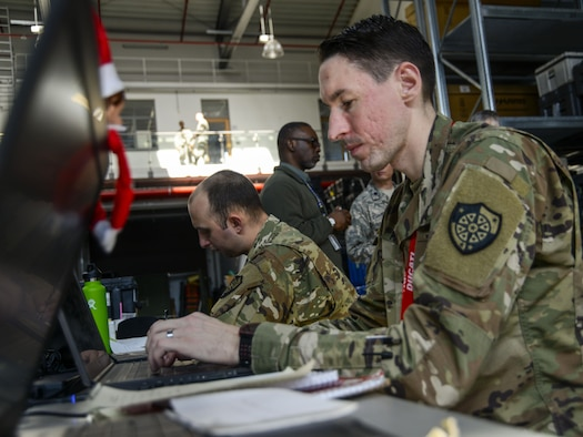 U.S. Army Staff Sgt. Matthew Malesinski, right, 201st Cyber Protection Team network security analyst, reviews data his team collected during a cyber security audit of the 1st Combat Communications Squadron's tactical communications kits March 16, 2017, on Ramstein Air Base, Germany. Representing the U.S. Army Cyber Protection Brigade, the members of the 201st CPT tested physical and internal security of the 1st CBCS' communications kits. The data they collected will be given to 1st CBCS leaders to help their operators increase the security of their systems. (U.S. Air Force photo/Staff Sgt. Timothy Moore)