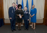 (Left to right) Brig. Gen. Steven S. Nordhaus, commander of the Air National Guard Readiness Center, Orlalyn Weston, Chief Master Sgt. Lorraine F. Regan, command chief of the ANGRC, and Rosalind E. Bishop, regional manager of Andrews Federal Credit Union, pose for a photo during the ANGRC annual awards ceremony at Joint Base Andrews, Md., 21 March, 2017. The ceremony formally recognized the top performing Airmen in leadership, job performance in their primary duties, significant self-improvement, and base and community involvement in 2016. (U.S. Air National Guard photo by Master Sgt. Marvin R. Preston)