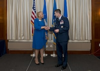 Brig. Gen. Steven S. Nordhaus, commander of the Air National Guard Readiness Center, thanks Rosalind E. Bishop, regional manager of Andrews Federal Credit Union, for continued support of the Air National Guard during the ANGRC annual awards ceremony at Joint Base Andrews, Md., 21 March, 2017. The ceremony formally recognized the top performing Airmen in leadership, job performance in their primary duties, significant self-improvement, and base and community involvement in 2016. (U.S. Air National Guard photo by Master Sgt. Marvin R. Preston)