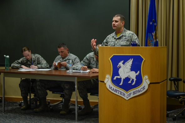Master Sgt. Matt Lofton, 2nd Space Operations Squadron, argues for the Top III Council during the Schriever Debate at Schriever Air Force Base, Colorado, Feb. 24, 2017. The council organizes the debates, in which participant's debate for or against pertinent topics in today's Air Force, such as the pros and cons of the blended retirement system. (U.S. Air Force photo/Christopher DeWitt)