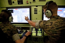 U.S. Marines assigned to the Unmanned Aerial System Operators Course, Marine Detachment Fort Huachuca, use a Universal Ground Data Terminal Control System simulation at Fort Huachuca, Ariz., March 17, 2017. The mission of Marine Detachment Fort Huachuca is to train intelligence and UAS Marines entry, intermediate, and advanced level skills for the Fleet Marine Force. (U.S. Marine Corps photo by Lance Cpl. Jose Villalobosrocha)