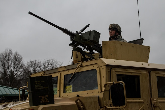 A tactical vehicle mounted with an M2 .50 caliber machine gun receives ammunition in preparation for  a live fire exercise at Range 26 on Fort McCoy, Wis., during Operation Cold Steel, April 03, 2017. Operation Cold Steel is the U.S. Army Reserve's crew-served weapons qualification and validation exercise to ensure that America's Army Reserve units and Soldiers are trained and ready to deploy on short-notice and bring combat-ready, lethal firepower in support of the Army and our joint partners anywhere in the world. (U.S. Army Reserve photo by Spc. Jeremiah Woods, 358th Public Affairs Detachment / Released)