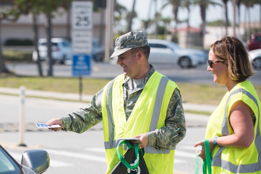 Col. Walt Jackim, 45th Space Wing vice commander, and Laura Tasker, 45th Space Wing sexual assault response coordinator, provide sexual assault prevention resources to members at Patrick Air Force Base, Fla., April 5, 2017.  Sexual assault can severely impact the 45th Space Wing's mission readiness, is not tolerated and does not adhere to Air Force Core Values. (U.S. Air Force photo by Phil Sunkel)