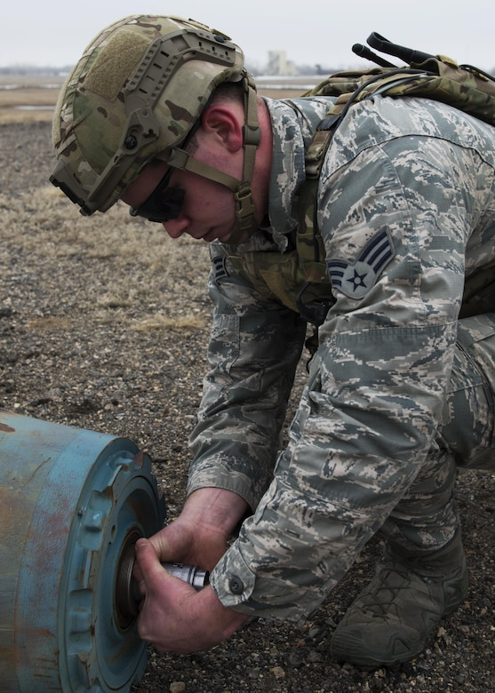 Senior Airman Adam Allen, 5th Civil Engineer Squadron explosive ordnance disposal team leader, removes an inert unexploded ordnance tail fuse at Minot Air Force Base, N.D., March 28, 2017. UXO recovery operations is one of the 10 mission-areas executed by EOD Airmen. (U.S. Air Force photo/Airman 1st Class Alyssa M. Akers)