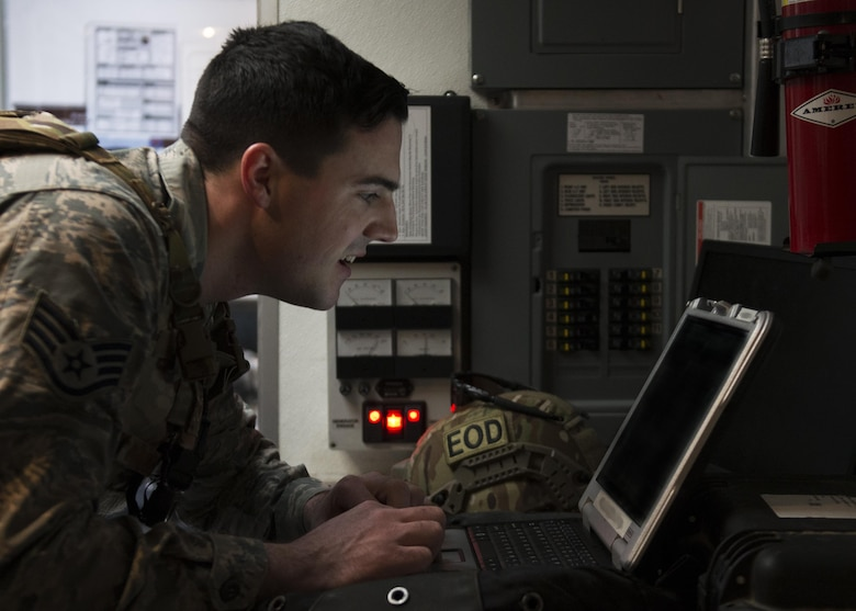 Staff Sgt. Steven Holbrook, 5th Civil Engineer Squadron explosive ordnance disposal team member, reviews mission-related information at Minot Air Force Base, N.D., March 28, 2017. Unexploded ordnance recovery operations is one of the 10 mission-areas executed by EOD Airmen. (U.S. Air Force photo/Airman 1st Class Alyssa M. Akers)
