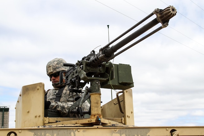 Army Reserve Spc. Joel Santana Rodriguez, from the 430th Quartermaster Company, based out of Fort Buchanan, Puerto Rico, prepares to clean an M2 .50 caliber machine gun after crew-served qualification during Operation Cold Steel at Fort McCoy, Wis., on March 31, 2017. The company is assigned to the 1st MSC, based out of Fort Buchanan, Puerto Rico, which provides mission command to assigned units of the Army Reserve in Puerto Rico and the U.S. Virgin Islands to ensure unit readiness to deploy to war and successfully execute their wartime missions. Operation Cold Steel is the U.S. Army Reserve's crew-served weapons qualification and validation exercise to ensure that America's Army Reserve units and Soldiers are trained and ready to deploy on short-notice and bring combat-ready, lethal firepower in support of the Army and our joint partners anywhere in the world. (U.S. Army Reserve photo by Spc. Jeremiah Woods, 358th Public Affairs Detachment / Released)