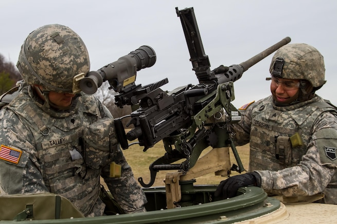 US Army Reserve Spc. Isaac Talley, a chemical, biological, radiological and nuclear specialist and US Army Sgt. Gregory Crespin a wheeled vehicle mechanic, both with the 277th Quartermaster Company, 76th Operational Response Command, inspect an M2 .50 caliber machine gun in preparation for qualification as part Operation Cold Steel at Fort McCoy, Wis., April 2, 2017. The 76th ORC is the Army Reserve's center for Defense Support of Civil Authorities, coordinating support to state and local officials, first responders and other federal agencies during emergencies or natural disasters. Operation Cold Steel is the U.S. Army Reserve's crew-served weapons qualification and validation exercise to ensure that America's Army Reserve units and Soldiers are trained and ready to deploy on short-notice and bring combat-ready, lethal firepower in support of the Army and our joint partners anywhere in the world. (U.S. Army Reserve photo by Spc. Jeremiah Woods, 358th Public Affairs Detachment / Released)