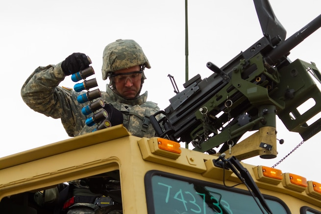 US Army Reserve Spc. Adam Paquet, a petroleum and supply specialist with the 277th Quartermaster Company, 377th Theater Sustainment Command, lifts rounds for a MK19 grenade launcher in preparation for qualification as part Operation Cold Steel at Fort McCoy, Wis., April 2, 2017. The 377th TSC is aligned with U.S. Southern Command, which oversees U.S. military interests in Latin America and the Caribbean. Operation Cold Steel is the U.S. Army Reserve's crew-served weapons qualification and validation exercise to ensure that America's Army Reserve units and Soldiers are trained and ready to deploy on short-notice and bring combat-ready, lethal firepower in support of the Army and our joint partners anywhere in the world. (U.S. Army Reserve photo by Spc. Jeremiah Woods, 358th Public Affairs Detachment / Released)