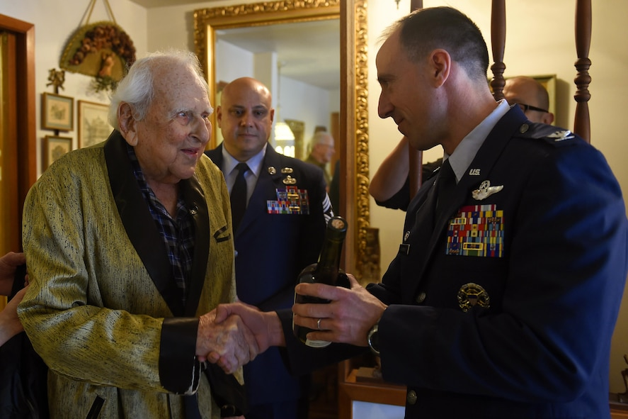 Col. (ret.) Ralph Jenkins (left), World War II 510th Fighter Squadron commander, receives a bottle of 1945 Calvados Brandy from Col. Leonard Kosinski (right), 62nd Airlift Wing commander and Chief Master Sgt. Tico Mazid, 62nd AW command chief at the Jenkins residence in Seattle, April 7, 2017. Jenkins celebrated a virtual toast with Maj. (ret.) M.E. Johns in Lompoc, California as their unit made a pact to do this when there was only two members of their squadron left. (U.S. Air Force photo/Tech. Sgt. Tim Chacon)