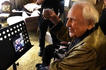 Col. (ret.) Ralph Jenkins (right), World War II 510th Fighter Squadron commander, virtually toasts through the Facetime application, Maj. (ret.) M.E. Johns, former 510th FS aviator, hosted at Vandenberg Air Force Base, California., during a toasting event April 7, 2017.  The two, along with the remaining members of their squadron, made a pact that when the last two members were left they would toast their fallen comrades and Jenkins and Johns made that pact happen with this event. (U.S. Air Force photo/Tech. Sgt. Tim Chacon)