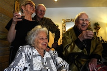 Col. (ret.) Ralph Jenkins (right), World War II 510th Fighter Squadron commander, along with his family at his residence in Seattle, raise a toast to the fallen comrades of the 510th FS, April 7, 2017.  The toast, using two bottle of 1945 Calvados Brandy, were transported across the country as a family member, Col. (United States Marine Corps ret.) Dick Dunnivan, of a deceased 510th squadron member made it happen. (U.S. Air Force photo/Tech. Sgt. Tim Chacon)