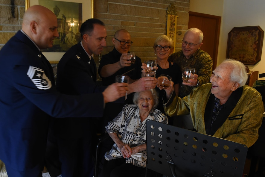 Col. (ret.) Ralph Jenkins (right), World War II 510th Fighter Squadron commander, along with his family and members of the 62nd Airlift Wing, Joint Base Lewis-McChord, Wash., at his residence in Seattle, raise a toast to the fallen comrades of the 510th FS, April 7, 2017. The toast was made possible as Airmen of McChord Field, part of Joint Base Lewis-McChord, Wash., and Airmen of Vandenberg Air Force Base, California worked together to ensure these heroes were reunited. (U.S. Air Force photo/Tech. Sgt. Tim Chacon)