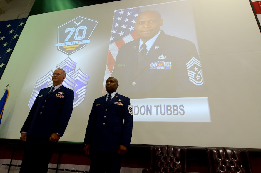 Brig. Gen. Steven Parker, 94th Airlift Wing, commander and Chief Master Sgt Lyndon Tubbs, 94th Airlift Wing, command chief, stand at attention during the opening of the retirement ceremony for Chief Tubbs honoring him for a successful 33 year military career held on Dobbins Air Reserve Base, Ga., April 2, 2017. (U.S. Air Force photo/Don Peek)