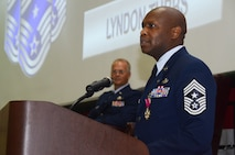 Chief Master Sgt Lyndon Tubbs, 94th Airlift Wing command chief, addresses a crowd of well-wishers attending his retirement ceremony held at Dobbins Air Reserve Base, Ga. April 2, 2017. Tubbs celebrated 33 years of successful military service. (U.S. Air Force photo/Don Peek)