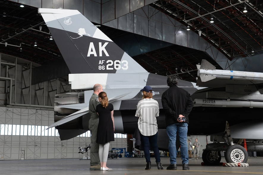 U.S. Air Force Col. Todd Robbins, the 354th Fighter Wing vice commander, speaks with Cassadee Pope and her tour manager about the F-16 Fighting Falcon aircraft April 8, 2017, at Eielson Air Force Base, Alaska. Robbins explained the functions of the F-16 and how it contributes to Eielson's mission of prepare, deploy and enable. (U.S. Air Force photo by Airman 1st Class Cassandra Whitman)