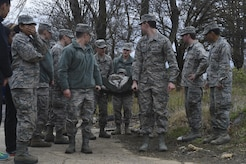 University of Maryland ROTC students look to each other for guidance while practicing a litter carry during training at Joint Base Andrews, Md., April 1, 2017. Approximately 120 students attended the training, led by the 11th Security Force Squadron. (U.S. Air Force photo by Senior Airman Mariah Haddenham)