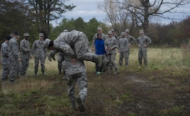 University of Maryland ROTC students practice carrying their classmates during training at Joint Base Andrews, Md., April 1, 2017. The students practiced entry control point challenging and procedures, combat medical readiness, tactical movements, and land navigation. The training was led by 11th Security Forces Squadron Airmen. (U.S. Air Force photo by Senior Airman Mariah Haddenham)