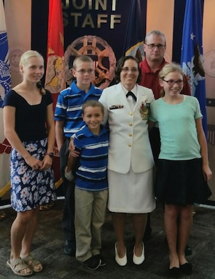 SUFFOLK, Va. - Karen Wingeart – the 2016 Naval Sea Systems Command (NAVSEA) Women Moving Forward Award winner – is pictured with her family upon her recent retirement from the Navy reserves. NAVSEA Commander Vice Adm. Thomas Moore announced Wingeart as the award winner in an April 2017 communiqué to NAVSEA employees based at Navy warfare centers and shipyards across the country. The Women Moving Forward award recognizes the contributions of individuals who promote equal opportunity in the workforce and continually make significant positive impacts to the command's mission and readiness. Wingeart - a the Navy's expert on Cooperative Engagement Capability systems for Ship Self-Defense Systems - served as a surface warfare officer and a meteorology and oceanography officer in her 20-year Navy career – 11 years on active duty and nine years in the reserves.