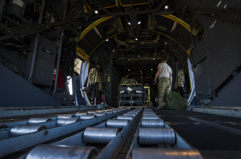 Loadmasters with the 15th Special Operations Squadron transport a container delivery system onto an MC-130 Combat Talon II at Hurlburt Field, Fla., April 7, 2017. The container delivery system is the most commonly used method for the quick, aerial insertion of supplies for military operations ensuring global reach anytime, anyplace. (U.S. Air Force photo by Airman 1st Class Joseph Pick)