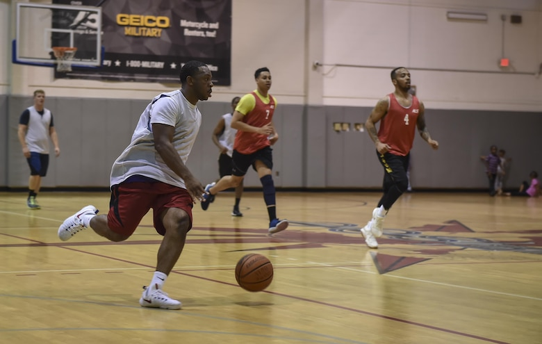 A member of the 1st Special Operations Civil Engineer Squadron basketball team, dribbles a basketball down court during the intramural basketball championship at the Aderholt Fitness Center on Hurlburt Field, Fla., April 6, 2017. The 1st SOCES bested the 1st Special Operations Medical Group by the score of 49 to 43. (U.S. Air Force photo by Airman 1st Class Joseph Pick)