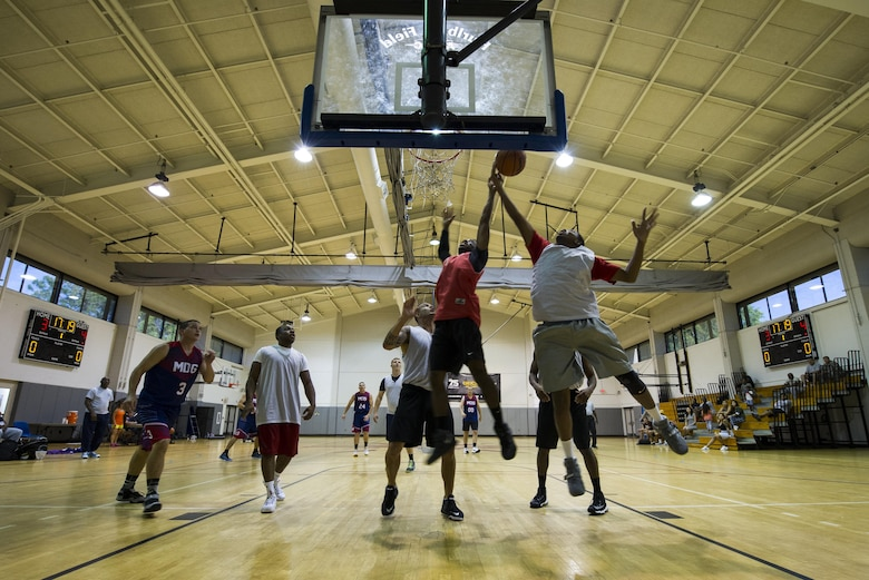 A member of 1st Special Operations Medical Group basketball team attempts a layup during the intramural basketball championship at the Aderholt Fitness Center on Hurlburt Field, Fla., April 6, 2017. For eight-weeks, 12 teams competing through a single-elimination tournament to qualify for the championship game. (U.S. Air Force photo by Airman 1st Class Joseph Pick)
