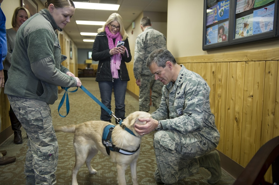 U.S. Air Force Lt. Gen. Kenneth Wilsbach, the 11th Air Force commander, meets with Tessa, the first Sexual Assault Prevention and Response dog, during a base visit March 31, 2017, at Eielson Air Force Base, Alaska. Beginning in the winter of 2016, the 5-month old Golden Retriever has already comforted seven victims, allowing the SAPR program to enhance its role around the 354th Fighter Wing. (U.S. Air Force photo by Airman 1st Class Isaac Johnson)