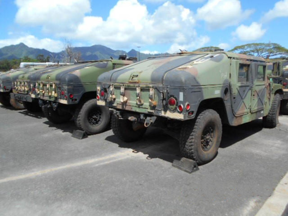 Vehicles from the Army's 25th Infantry Division are arriving at DLA Disposition Services site at Pearl Harbor, Hawaii, to begin the disposal process.