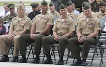 Leaders of 2nd Marine Division sit in the front row during a memorial ceremony for fallen Marines with 2nd Light Armored Reconnaissance Battalion, 2nd Marine Division at Camp Lejeune, N.C., April 7, 2017. Sitting left to right: Command Master Chief Jody Gene Fletcher, Division Sergeant Major, Sgt. Maj. Michael P. Woods, Assistant Division Commander Col. Benjamin T. Watson and 2nd LAR Battalion Sergeant Major, Sgt. Maj. David Compton. The ceremony honored fallen Marines as well as families and friends of the 2nd LAR community. (U.S. Marine Corps photo by Lance Cpl. Raul Torres)