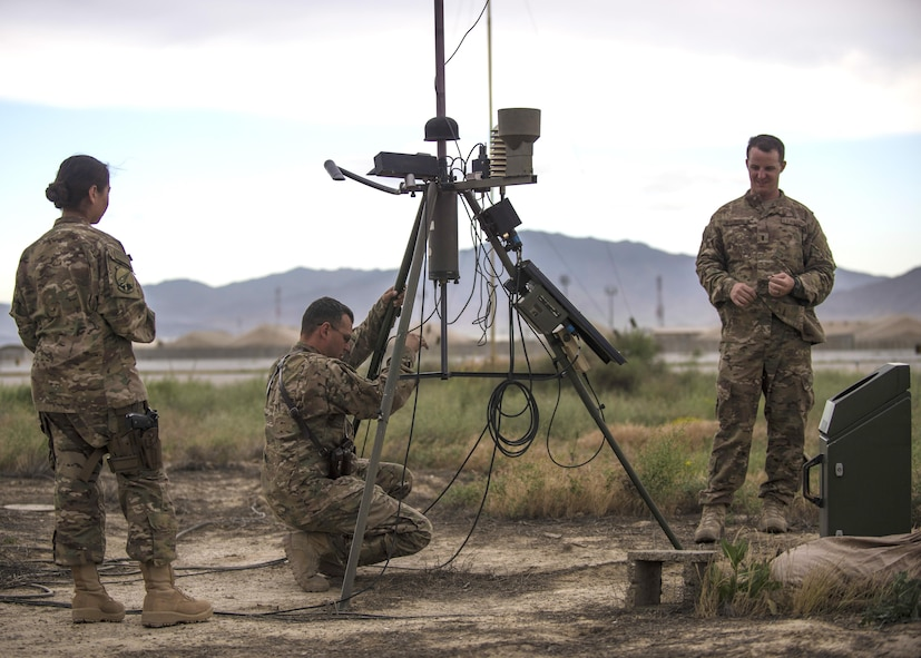 Members of the 455th Expeditionary Operations Support Squadron conduct an inspection of a Tactical Meteorological Observation System, or TMQ-53, at Bagram Airfield, Afghanistan, May 16, 2016. The TMQ-53 collects weather data that includes wind speed and direction, temperature, humidity, cloud height, precipitation and lightning. This data is compiled with more than 100 years of climatological observations stored by the 14th Weather Squadron in Asheville, North Carolina. (U.S. Air Force photo by Senior Airman Justyn M. Freeman)