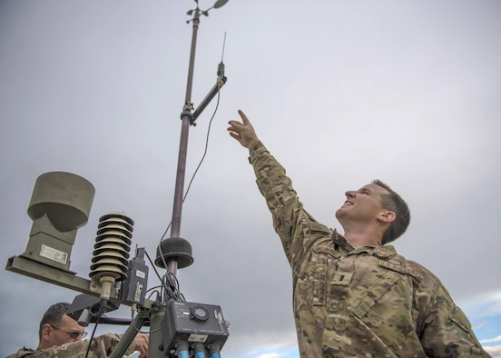 1st Lt. Justin D'olimpio, 455th Expeditionary Operations Support Squadron weather flight commander, points at a Tactical Meteorological Observation System, or TMQ-53, at Bagram Airfield, Afghanistan, May 16, 2016. Global weather stations like these feed meteorological data collection efforts logged by Airmen at the 14th Weather Squadron in Asheville, North Carolina. (U.S. Air Force photo by Senior Airman Justyn M. Freeman)