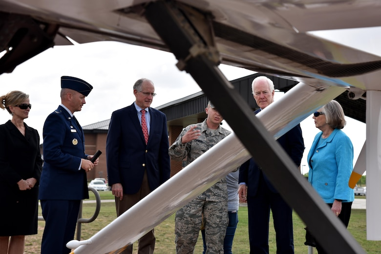 U.S. Air Force Tech. Sgt. Aaron Dvorak, 315th Training Squadron geospatial intelligence analysis course chief, explains to Sen. John Cornyn III, Senate Majority Whip for the 115th Congress, the reason why we have a RQ-1 Predator aircraft display on Goodfellow Air Force Base, Texas, April 10, 2017. After his overview of the aircraft, Cornyn held a press conference. (U.S. Air Force photo by Staff Sgt. Joshua Edwards/Released)