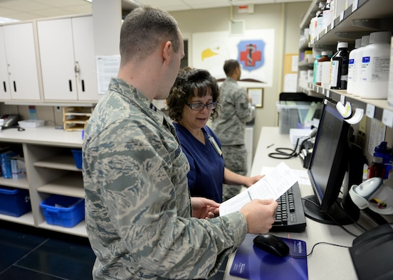 Members of the Altus Air Force Base pharmacy prepare a cold medication pack, April 10, 2017, at Altus Air Force Base, Oklahoma. The base pharmacy offers cold medication packs to those who meet their qualifications to help cut down on patient and health care provider's time and money. (U.S. Air Force Photo by Airman 1st Class Jackson N. Haddon/Released).