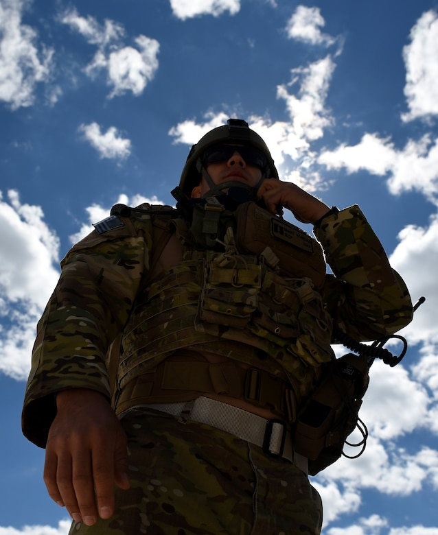 Capt. Grant McIntire, 14th Air Support Operations Squadron tactical air control party, listens to communications during exercise Razor Talon, April 7, 2017, at Atlantic Field Marine Corps Outlying Field, North Carolina. Razor Talon is a low-cost, large-force training exercise for joint East Coast tactical and support aviation units. (U.S. Air Force photo by Airman 1st Class Kenneth Boyton)
