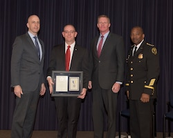 Army Lt. Col. James Jones, assigned to the White House medical evaluation and treatment unit, was presented a lifesaving award from William J. Callahan, the acting director of the Secret Service, at Secret Service Headquarters in Washington, April 6, 2017. Pictured left to right are Callahan; Jones; George Mulligan, Secret Service chief operating officer; and Kevin Simpson, chief of the Secret Service uniformed division. Photo courtesy of Secret Service