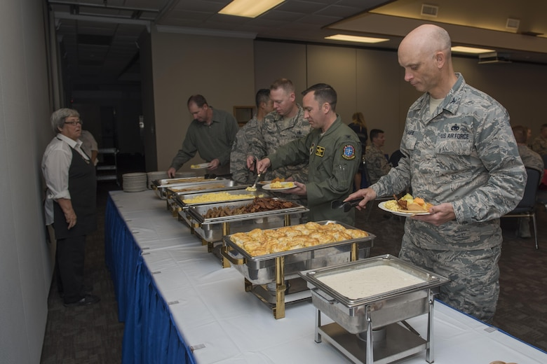 Col. Timothy Gillaspie, 82nd Training Wing vice commander, leads Sheppard Air Force Base, Texas, leadership through the breakfast line at the Annual Air Force Assistance Fund kickoff breakfast, April 10, 2017. The contributions made to the AFAF Campaign help Airmen, families and retirees by providing services such as support for emergency needs, educational assistance and family support to include comfort to Air Force widows. (U.S. Air Force photo by Staff Sgt. Kyle E. Gese)