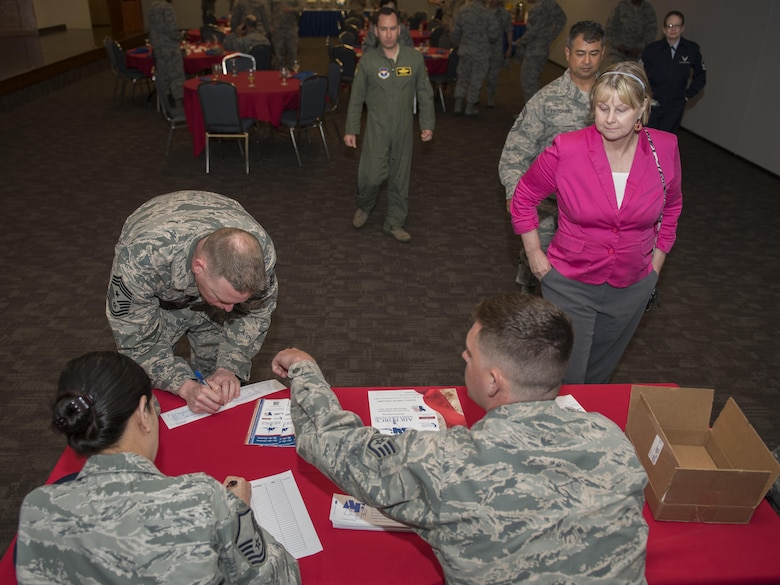 Chief Master Sgt. Benjamin Hedden, 80th Flying Training Wing command chief, signs one of the first donations to this year's Air Force Assistance Fund Campaign at Sheppard Air Force Base, Texas, April 10, 2017. The contributions made to the AFAF Campaign help Airmen, families and retirees by providing services such as support for emergency needs, educational assistance and family support to include comfort to Air Force widows. (U.S. Air Force photo by Staff Sgt. Kyle E. Gese)