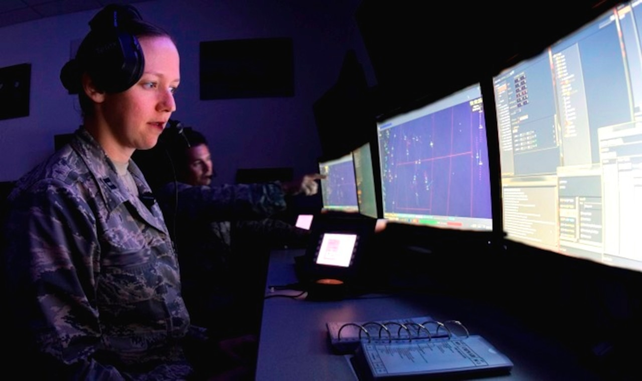 Airmen at Tinker Air Force Base, Oklahoma, are illuminated by the glow of the blue light from their computer screens. Blue light blocks the brain's production of melatonin, an important chemical that helps people sleep. New lenses developed by the Navy are designed to be worn for a couple of hours before bedtime and will block the blue light, allowing warfighters to get better sleep. Air Force photo by Greg L. Davis