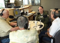 Col. Thomas K. Smith, Jr., 433rd Airlift Wing commander, speaks with John Thurman, Heart of Texas Realty, Bjorn Dybdahl, Bjorns Audio Video, and Klaus Weiswurm, Innovation Technology Machinery, on the San Antonio's Movers and Shakers radio program April 8, 2017 at the 930AM The Answer studios. The show celebrates education, business, civic, and public leaders who keep the entrepreneurial spirit alive in San Antonio.  (U.S.  Air Force photo by Benjamin Faske)